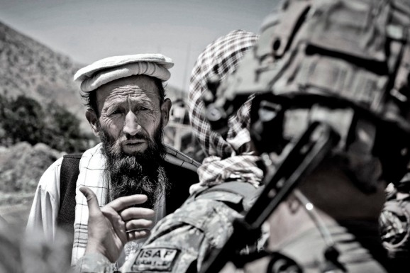 Afghan elder, interpreter, ISAF soldier
