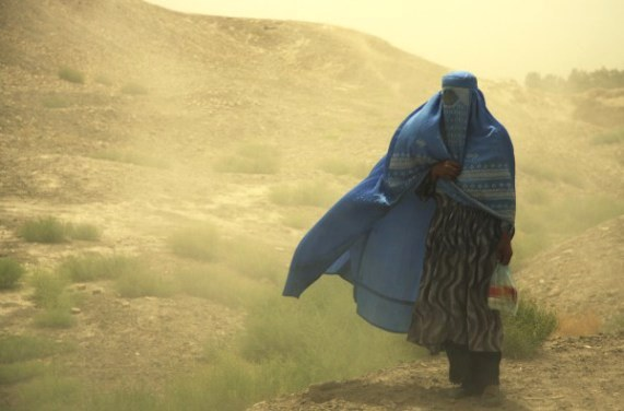 afghan woman in sand-storm