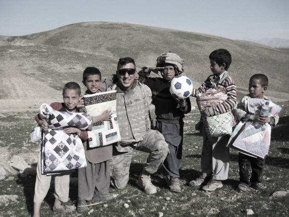 village boys with gifts Afghanistan